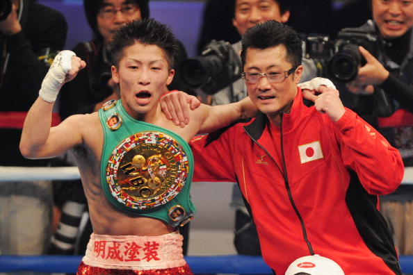 TOKYO, JAPAN - APRIL 06: New champion,Naoya Inoue (L) and his father Shingo Inoue celebrate the victory after the WBC light flyweight title bout between Adrian Hernandez of Mexico v Naoya Inoue of Japan at Ota City General Gymnasium on April 6, 2014 in Tokyo, Japan. (Photo by Masashi Hara/Getty Images)